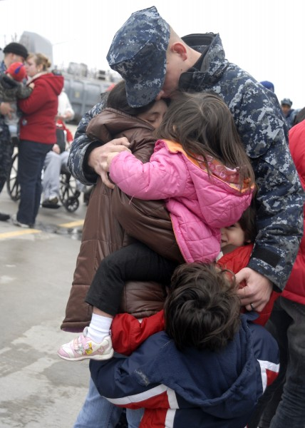 US Navy 100121-N-5087R-035 Fire Controlman 2nd Class Josh Holliday embraces his family