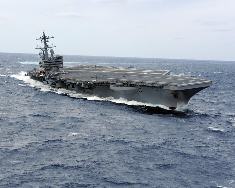 US Navy 100227-N-1854W-716 USS George H.W. Bush (CVN 77) heels hard to starboard during high-speed drills