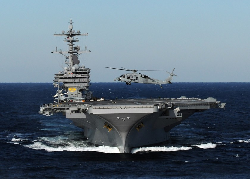 US Navy 100227-N-4408B-163 An MH-60S Sea Hawk helicopter hovers above the bow of USS George H.W. Bush (CVN 77) during flight operations