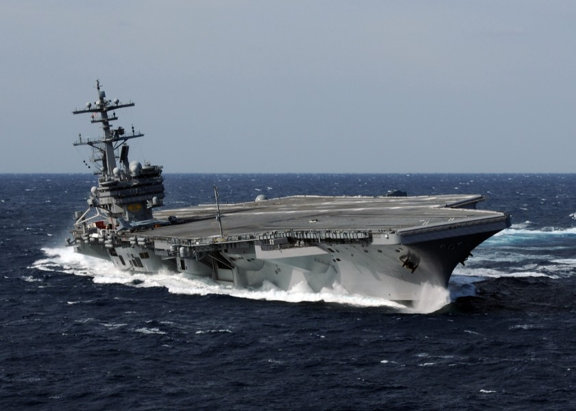 US Navy 100227-N-4408B-613 USS George H.W. Bush (CVN 77) heels hard to starboard during high-speed drills