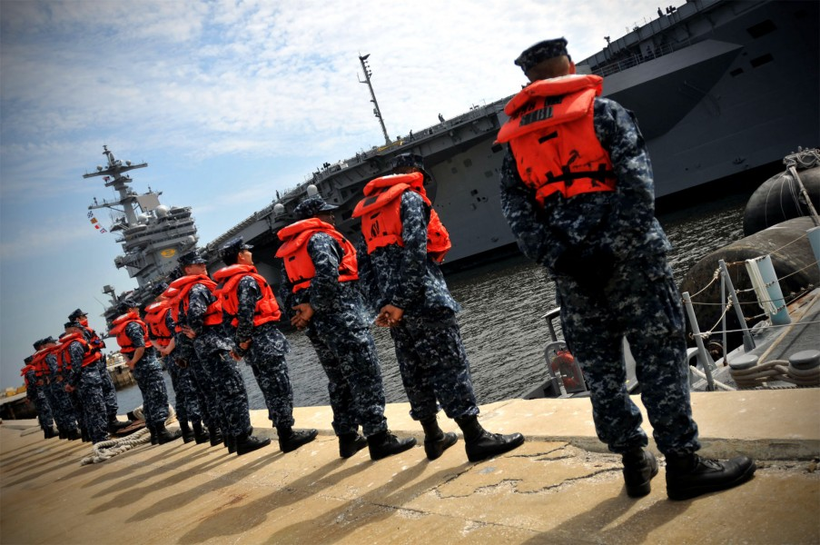 US Navy 100310-N-8590G-005 Sailors stand by for line handling as USS George H.W. Bush (CVN 77) approaches the pier at Naval Station Mayport