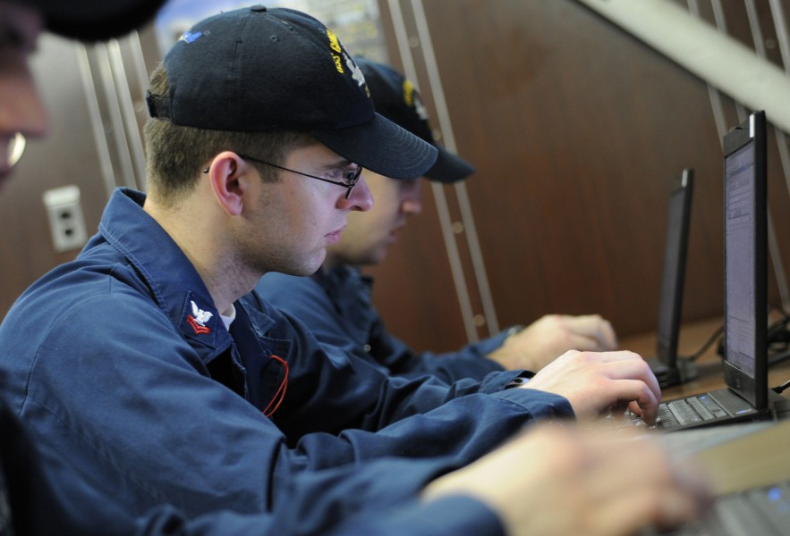 US Navy 100419-N-8913A-047 Sailors assigned to the aircraft carrier USS George H.W. Bush (CVN 77) check their e-mail in the ship's library