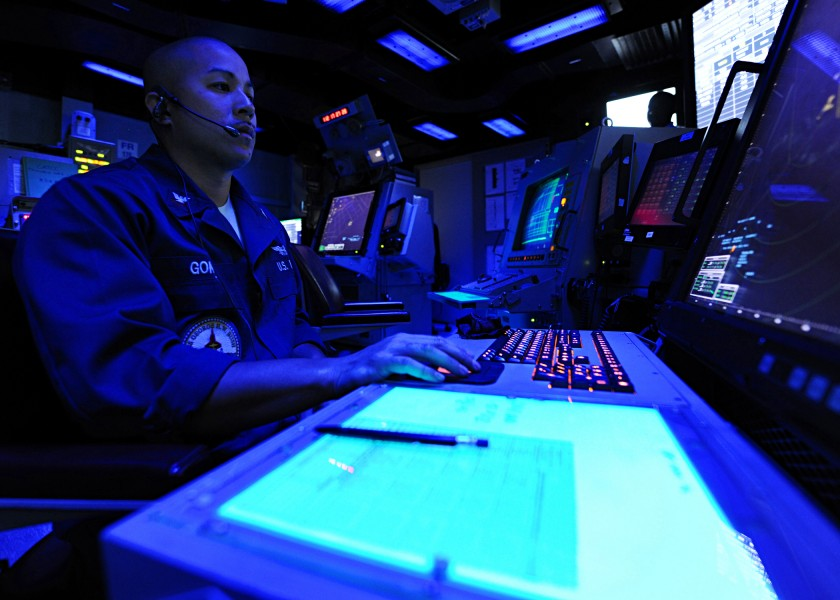 US Navy 100422-N-3885H-020 Air Traffic Controller 2nd Class Bruce Gomez stands watch in the Carrier Air Traffic Control Center aboard the aircraft carrier USS George H.W. Bush (CVN 77)