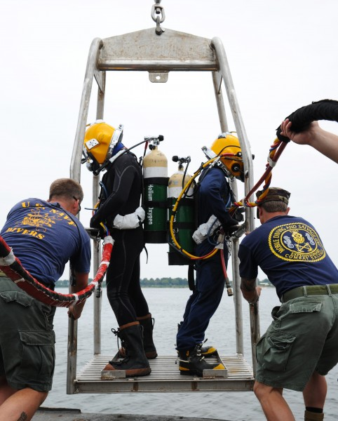US Navy 100712-N-9769P-494 Navy Divers are lowered from the Military Sealift Command fleet ocean tug USNS Apache (T-ATF 172)