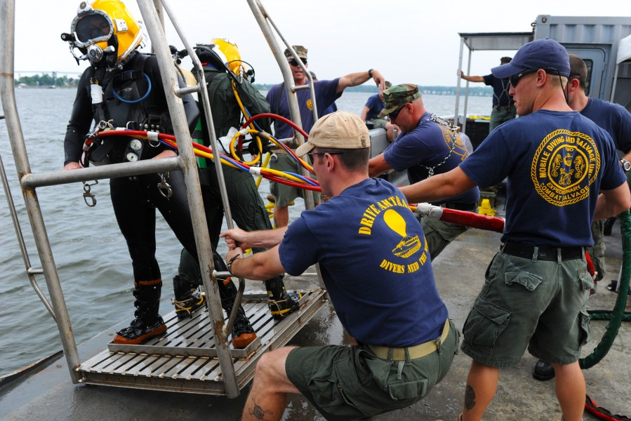 US Navy 100712-N-9769P-738 Navy Divers are pulled onto the Military Sealift Command fleet ocean tug USNS Apache (T-ATF 172) on a diving stage after a dive