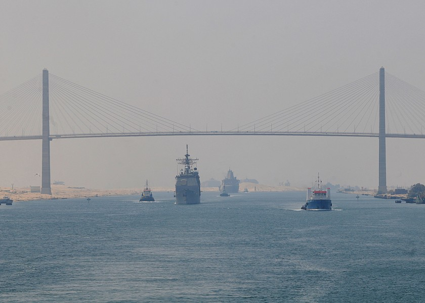 US Navy 100718-N-1082Z-073 The guided-missile cruiser USS San Jacinto (CG 56) and the amphibious transport dock ship USS Mesa Verde (LPD 19) pass under the Egyptian-Japanese Friendship Bridge