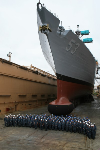 US Navy 100907-N-0121W-001 Sailors stand in front of USS John Paul Jones (DDG 53) during its last day in dry dock