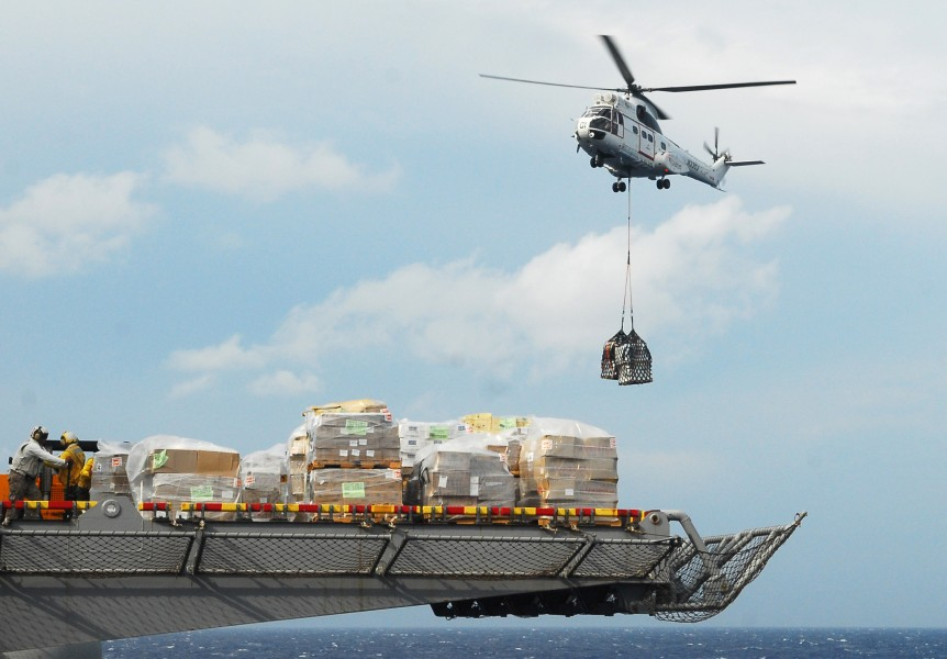 US Navy 101021-N-2218S-195 An AS332 Super Puma helicopter moves pallets of supplies to the amphibious assault ship USS Essex (LHD 2)