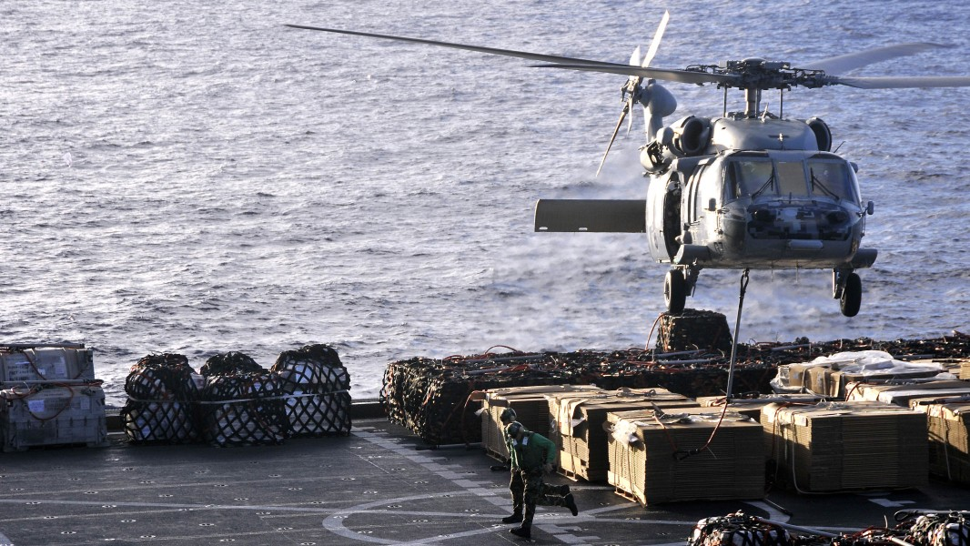 US Navy 101025-N-7103C-076 An MH-60S Sea Hawk helicopter assigned to the Island Knights of Helicopter Sea Combat Squadron (HSC) 25 lifts cargo from