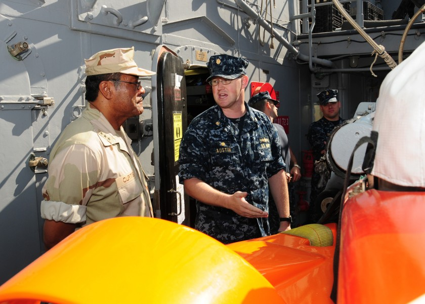 US Navy 101029-N-2903B-003 Lt. Cmdr. Spencer Austin explains the capabilities of an SLQ-48 Mine Neutralization Vehicle to Vice Adm. D.C. Curtis