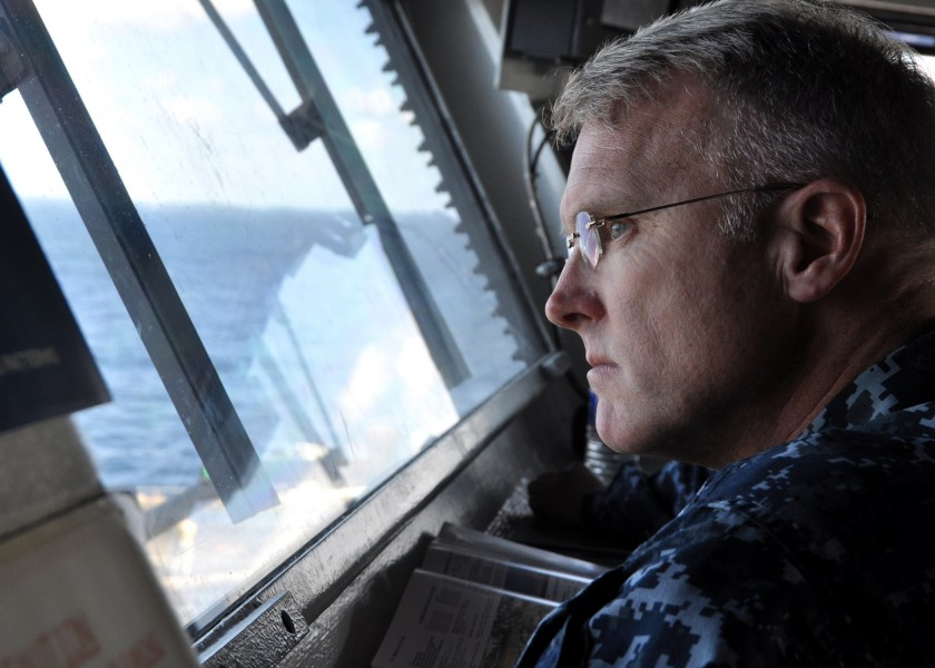 US Navy 101109-N-0981M-039 Rear Adm. Thomas Rowden, commander of Carrier Strike Group 7 oversees the vertical replenishment of supplies