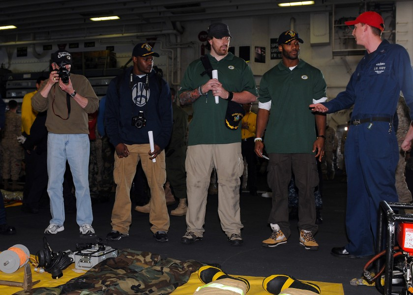 US Navy 110214-N-2908M-074 Super Bowl XLV champions, the Green Bay Packers, are briefed on fire fighting equipment by Damage Controlman 2nd Class S