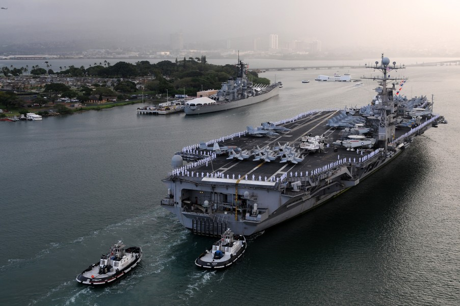 US Navy 110310-N-PM781-330 The aircraft carrier USS Abraham Lincoln (CVN 72) enters Pearl Harbor for a port visit
