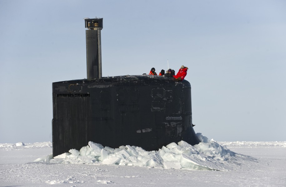 US Navy 110319-N-UH963-235 The crew of USS Connecticut (SSN 22) observe members of the Applied Physics Laboratory Ice Station clear ice from the su