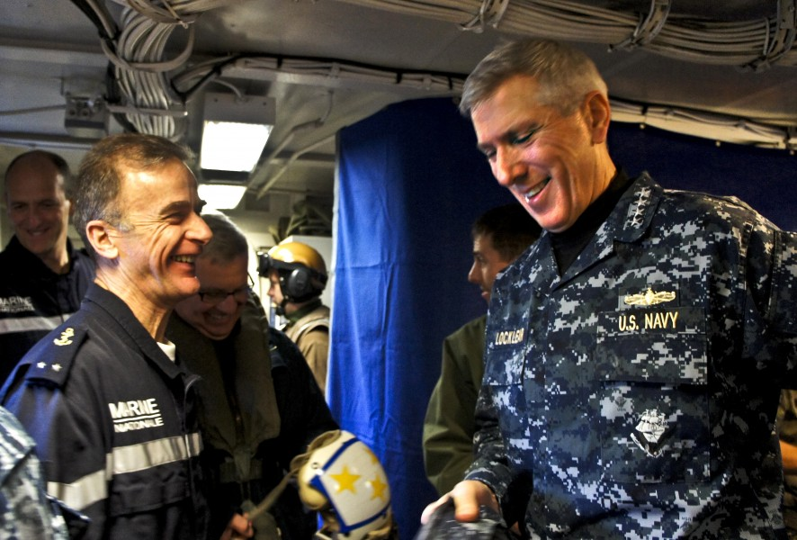 US Navy 110321-N-0000X-039 Adm. Samuel J. Locklear, III speaks with French navy Rear Adm. Philippe Coindreau aboardCharles de Gaulle (R91)