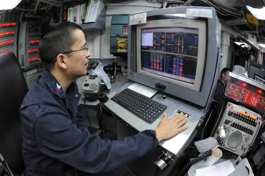 US Navy 110323-N-8497H-110 Electrician's Mate 1st Class Jaime Garcia monitors the electronic propulsion plant console