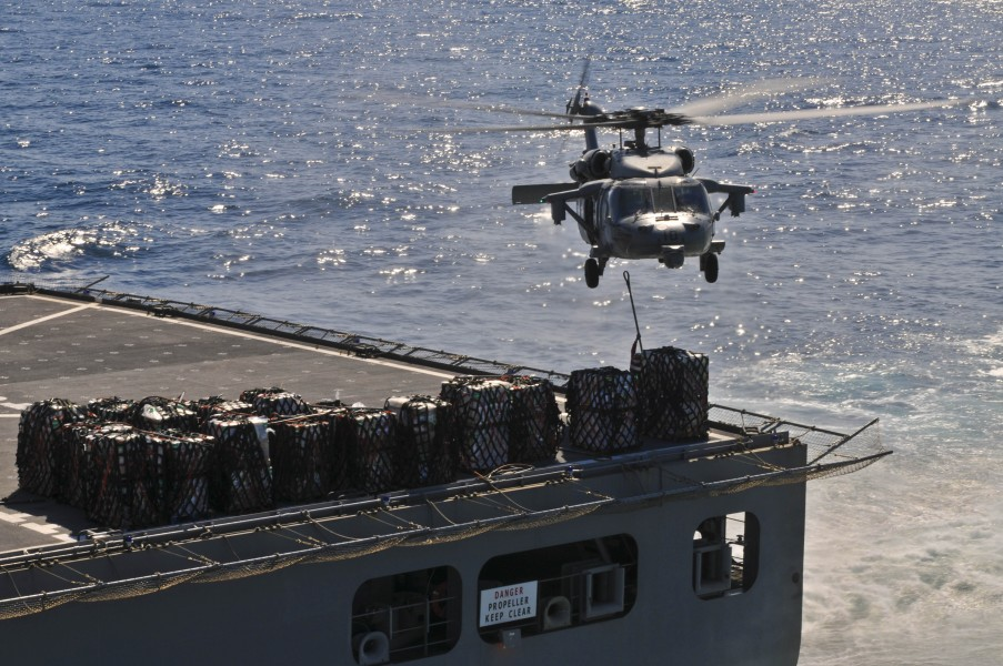 US Navy 110403-N-9950J-278 An MH-60S Sea Hawk helicopter picks up supplies from USNS Matthew Perry (T-AKE 9) during a vertical replenishment