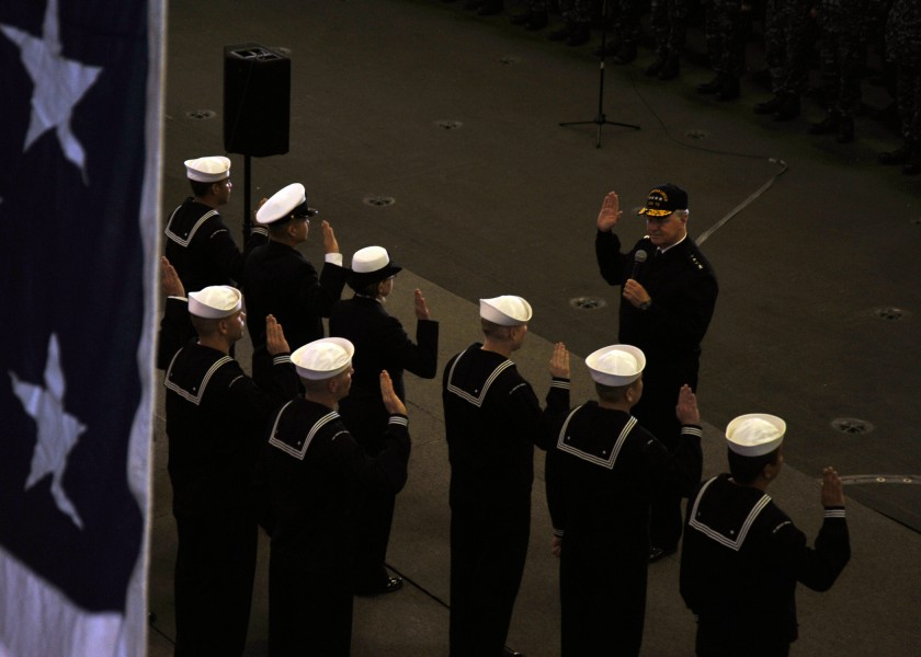 US Navy 110510-N-YB753-024 Chief of Naval Operations (CNO) Adm. Gary Roughead administers the oath of enlistment to ten Sailors aboard USS Abraham
