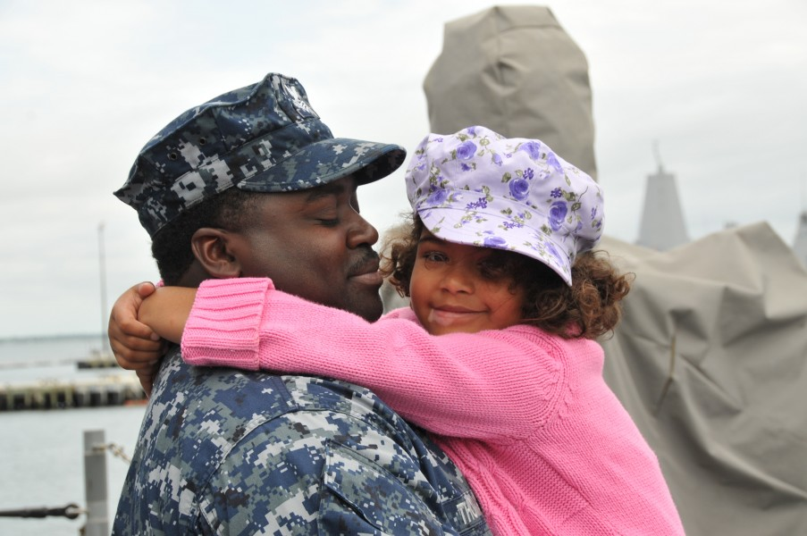 US Navy 110511-N-QY430-007 Fire Controlman 1st Class Rodney Thomas holds his daughter one last time aboard the guided-missile cruiser USS Anzio (CG