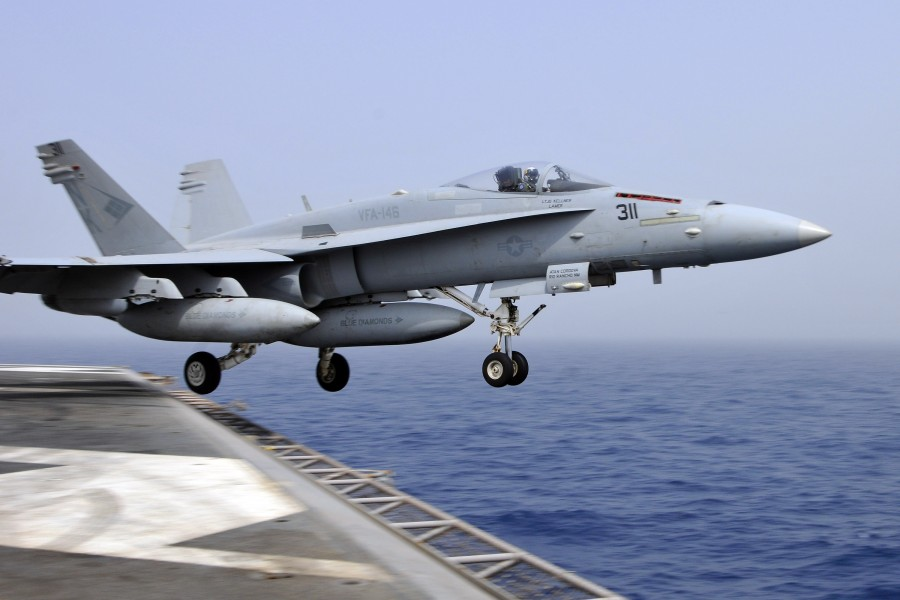 US Navy 110718-N-EE987-019 An F-A-18C Hornet assigned to the Blue Diamonds of Strike Fighter Squadron (VFA) 146 catapults from the aircraft carrier