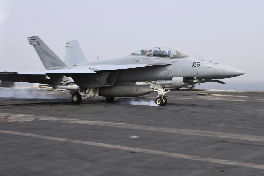 US Navy 110718-N-EE987-106 An F-A-18F Super Hornet assigned to the Black Knights of Strike Fighter Squadron (VFA) 154 lands aboard the aircraft car
