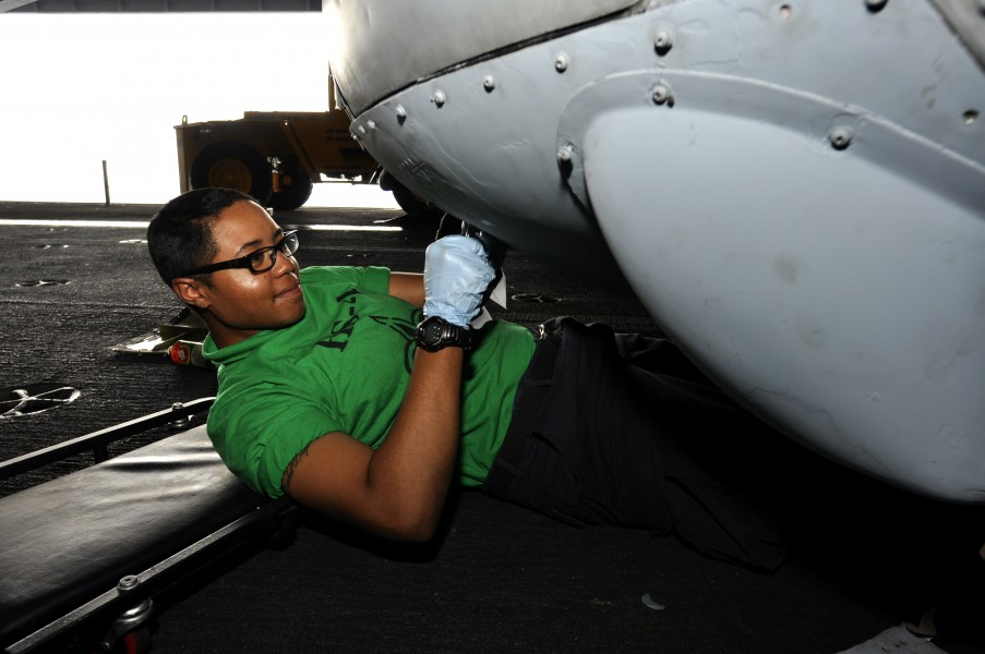 US Navy 110719-N-ZZ999-007 Aviation Structural Mechanic 3rd Class Angelina Rhines, from Phoenix, installs panels on an HH-60H Sea Hawk helicopter