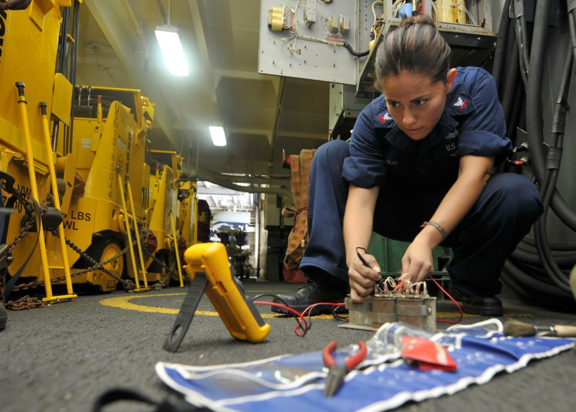 US Navy 110723-N-EE987-125 Electrician's Mate 2nd Class Maria Arreedondo, from Houston, uses a flow divider while fixing a forklift battery chargin