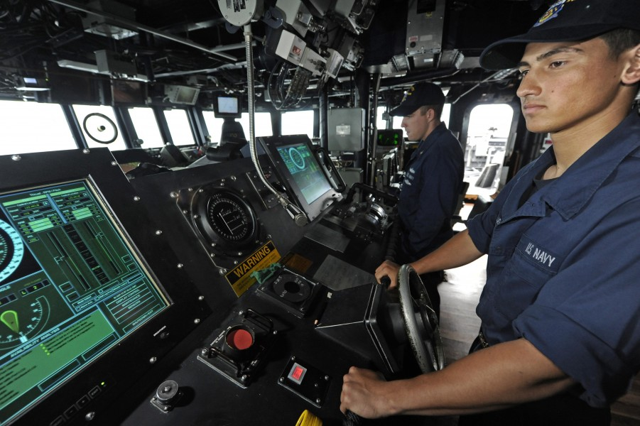 US Navy 110916-N-VH839-080 eaman Art Casillas, a helmsman aboard the Arleigh Burke-class guided-missile destroyer USS Dewey (DDG 105), steers the s