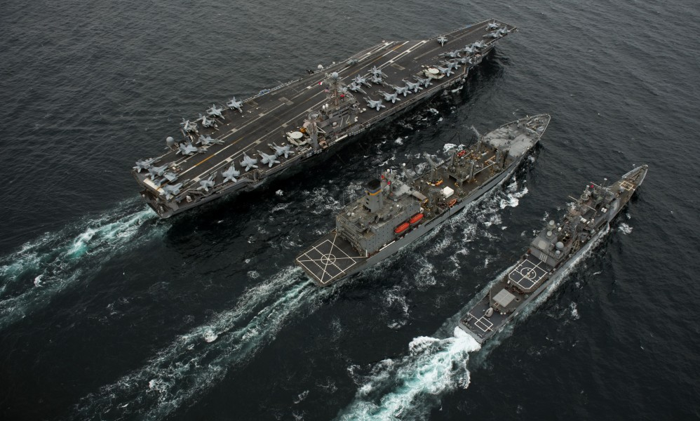 US Navy 110926-N-TU221-619 USS Abraham Lincoln (CVN 72), left, USNS Guadalupe (T-AO 200) and USS Cape St. George (CG 71) conduct a replenishment at