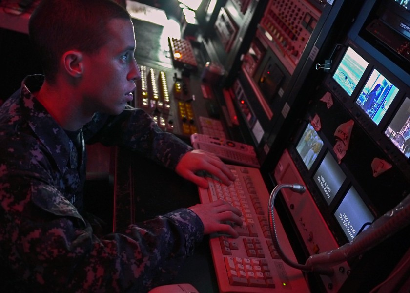 US Navy 110928-N-OE749-001 Mass Communication Specialist Seaman Zachary Welch updates a training schedule from the site TV control room
