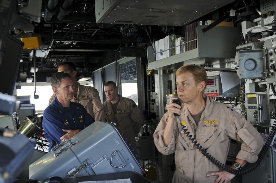US Navy 111003-N-YM590-026 Rear Adm. Nora Tyson, commander of Carrier Strike Group (CSG) 2, right, addresses the crew of the guided-missile cruiser