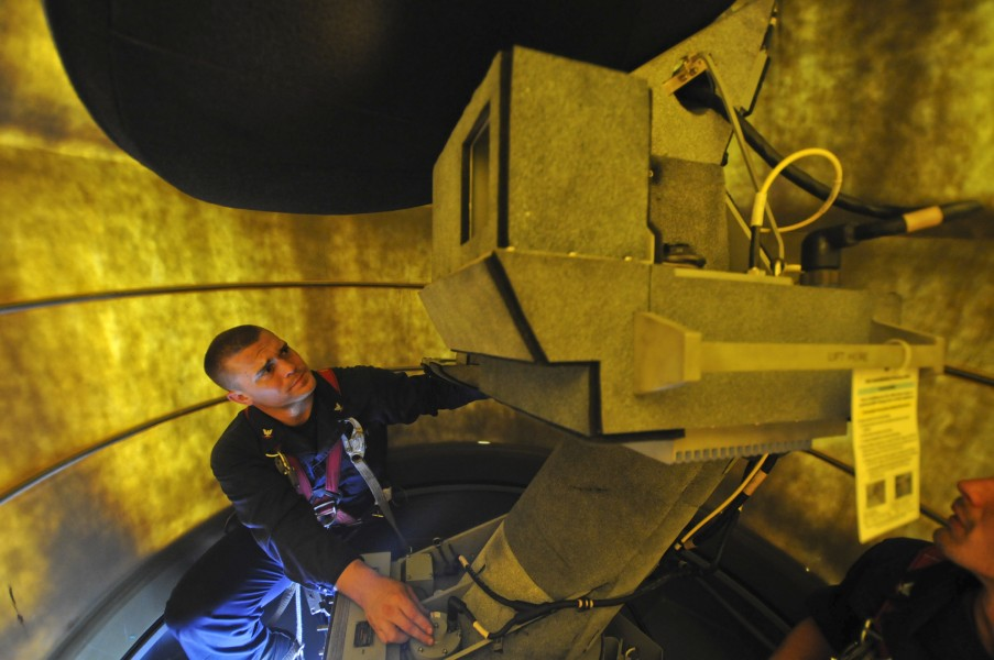 US Navy 111016-N-ZZ999-027 Electronics Technician 3rd Class Robert Taylor performs maintenance on a radar terminal aboard the guided-missile cruise