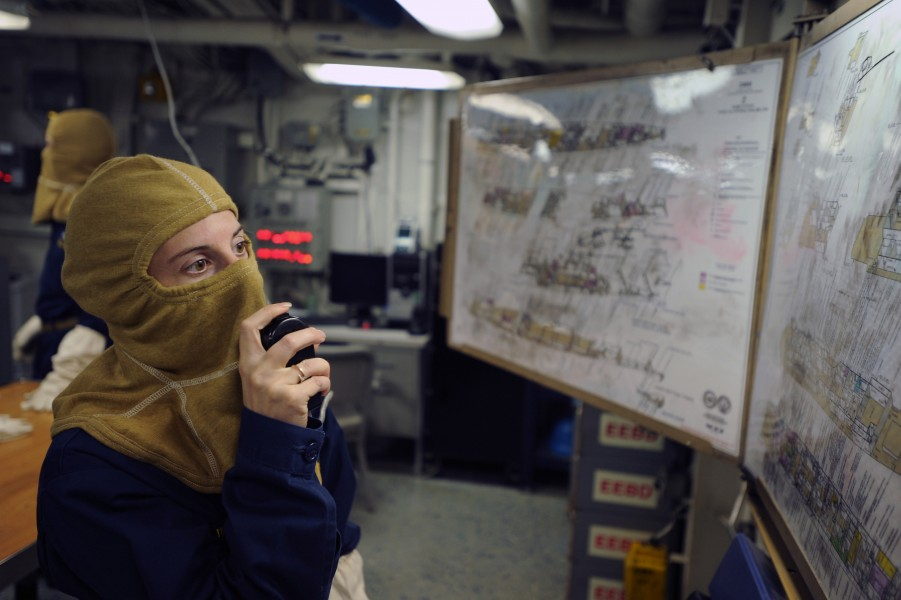 US Navy 111106-N-AX571-012 Lt. j.g. Karen Lingner speaks on the ship's one MC system during a general quarters drill