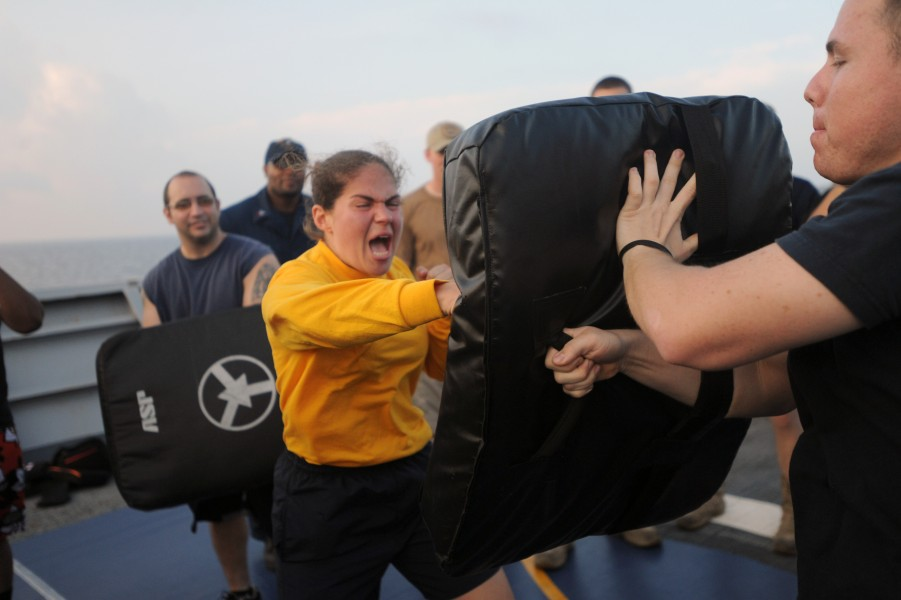 US Navy 111106-N-AX571-374 Ensign Arielle Holland hits the striking bag after being sprayed with oleoresin capsicum during security reaction force