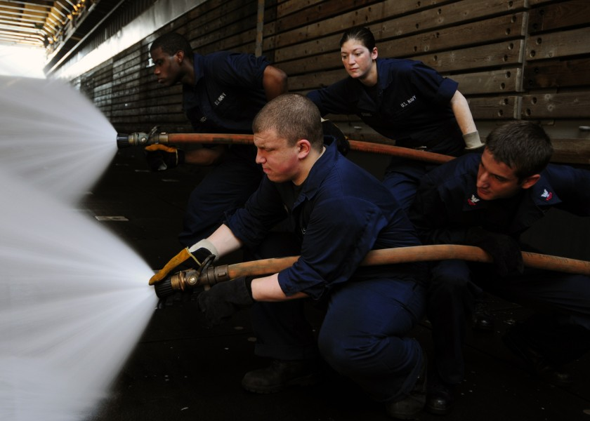 US Navy 111121-N-WJ771-146 Sailors man a fire hose during a crash and salvage drill