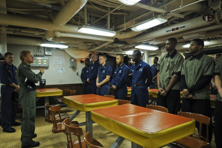 US Navy 111122-N-YM590-034 Rear Adm. Nora W. Tyson, commander of Carrier Strike Group (CSG) 2, left, speaks with Sailors during a visit aboard the