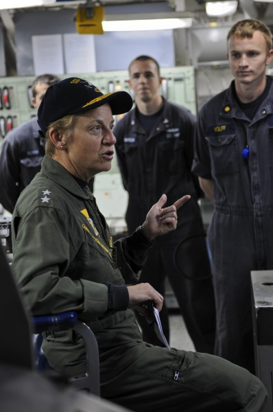 US Navy 111122-N-YM590-075 Rear Adm. Nora W. Tyson, commander of Carrier Strike Group (CSG) 2, left, speaks with Sailors in the central control sta
