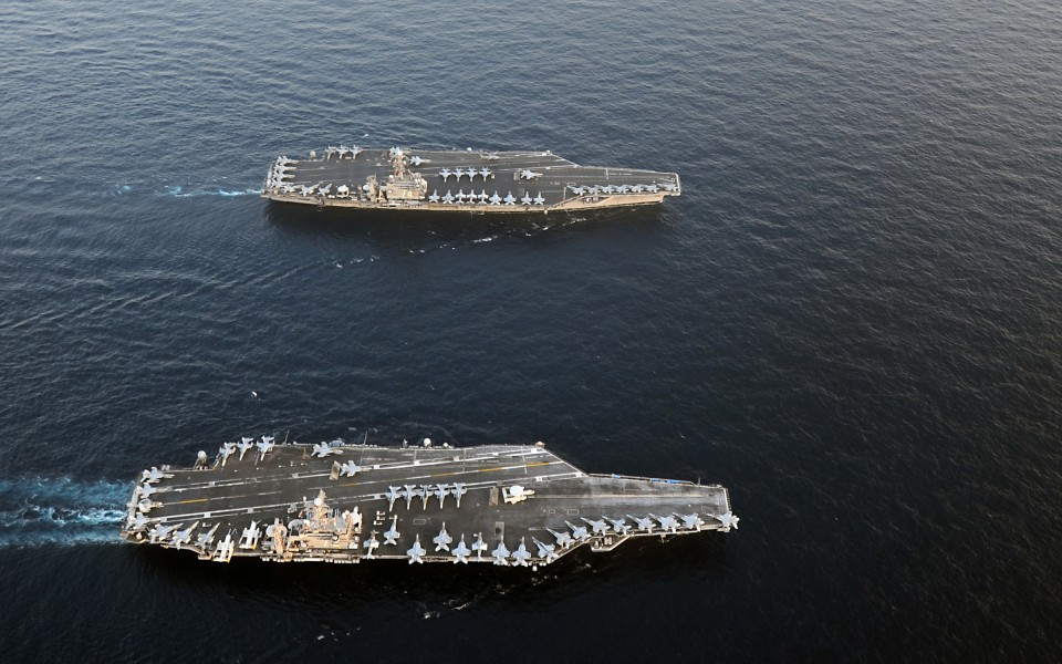 US Navy 120119-N-QH883-124 The Nimitz-class aircraft carriers USS Abraham Lincoln (CVN 72) and USS John C. Stennis (CVN 74) join for a turnover of