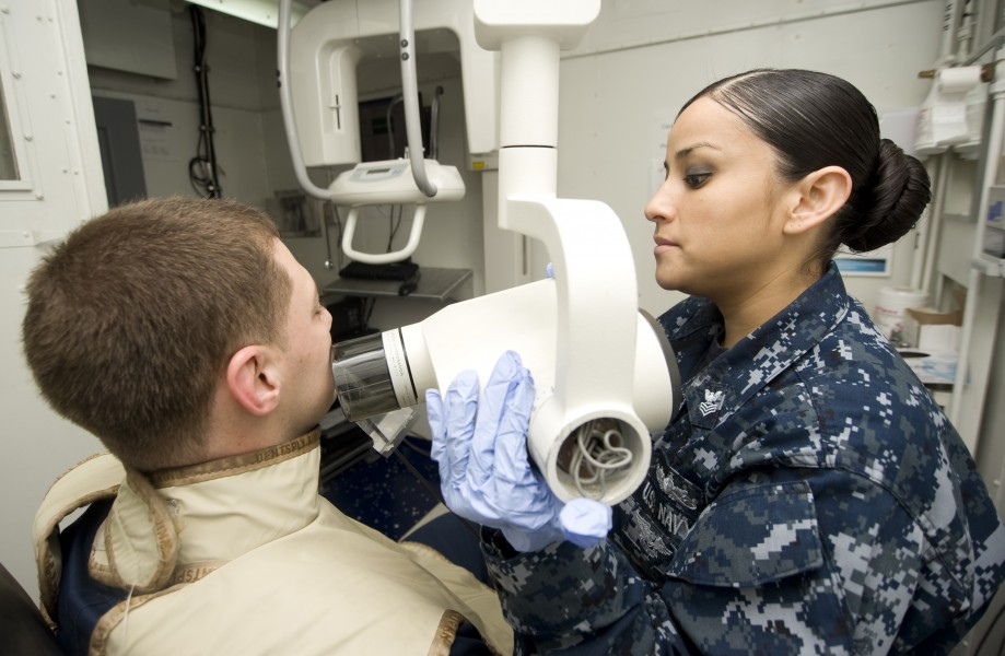 US Navy 120131-N-JN664-014 Hospital Corpsman 1st Class Laura Blanco takes X-rays of Electrician's Mate 1st Class Cory Hartley aboard the Nimitz-cla