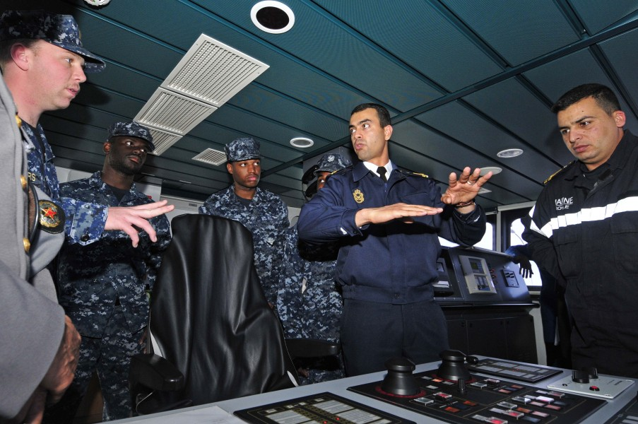 US Navy 120202-N-IZ292-146 Sailors from the guided-missile frigate USS Simpson (FFG 56) receive a brief from Royal Moroccan Navy Ensign Nabil Elkor
