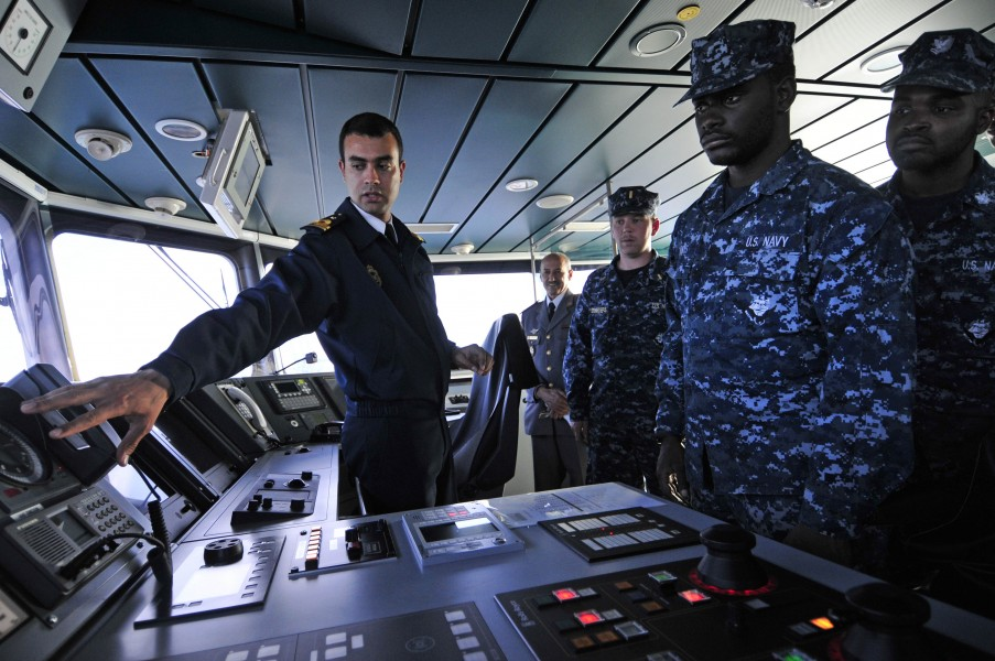 US Navy 120202-N-IZ292-154 Royal Moroccan Naval Ensign Nabil Elkorchi gives a briefing to Sailors from the guided-missile frigate USS Simpson (FFG