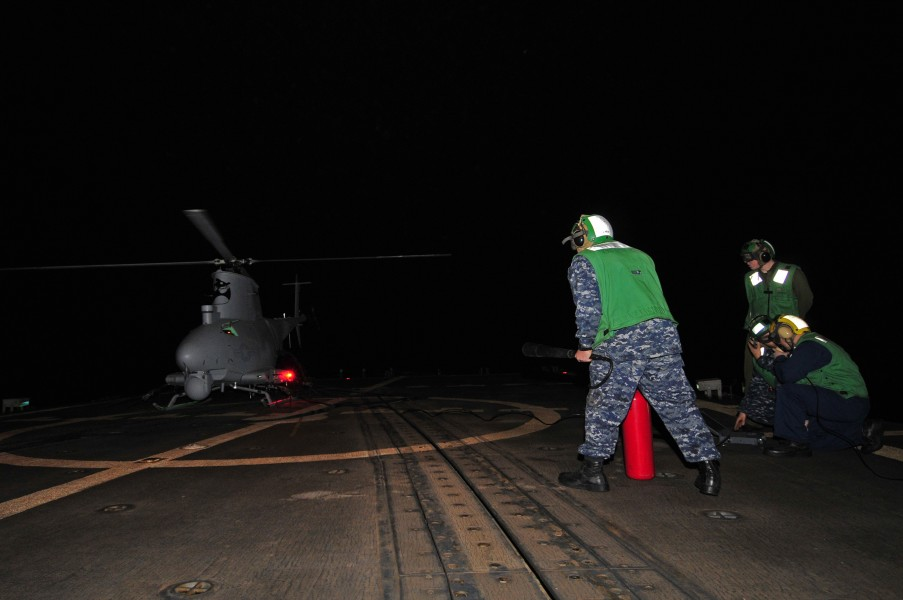 US Navy 120208-N-IZ292-062 Sailors prepare to launch an MQ-8B Fire Scout unmanned aerial vehicle (UAV) during nighttime flight operations aboard th