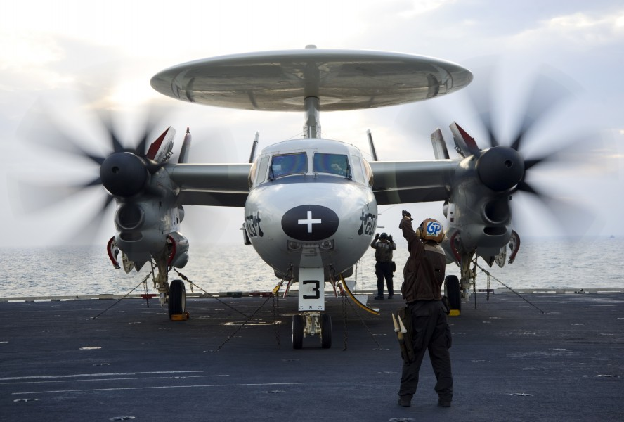 US Navy 120213-N-JN664-083 A plane captain relays hand signals between maintainers and pilots of an E-2C Hawkeye assigned to the Sun Kings of Airbo