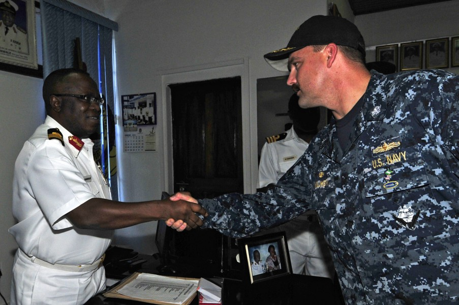 US Navy 120215-N-IZ292-001 Cmdr. Leonard Milliken, commanding officer of the guided-missile frigate USS Simpson (FFG 56), greets Nigerian navy Rear