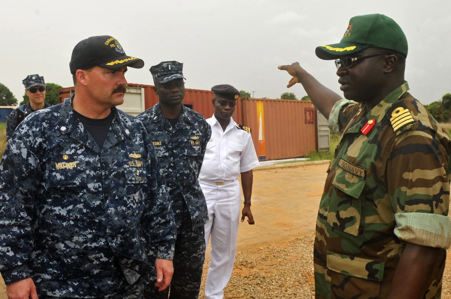 US Navy 120215-N-IZ292-243 Cmdr. Leonard Milliken, commanding officer of the guided-missile frigate USS Simpson (FFG 56), is briefed by Nigerian na