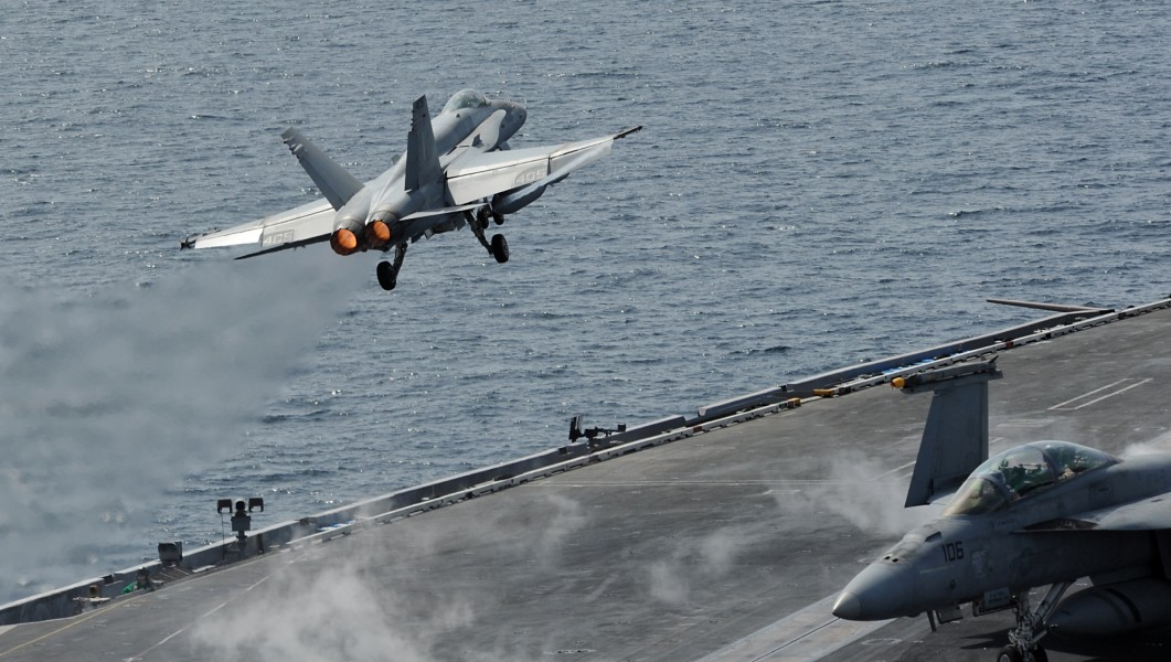 US Navy 120216-N-VO377-376 An F-A-18C Hornet assigned to the Blue Blasters of Strike Fighter Squadron (VFA) 34 launches from the flight deck of the