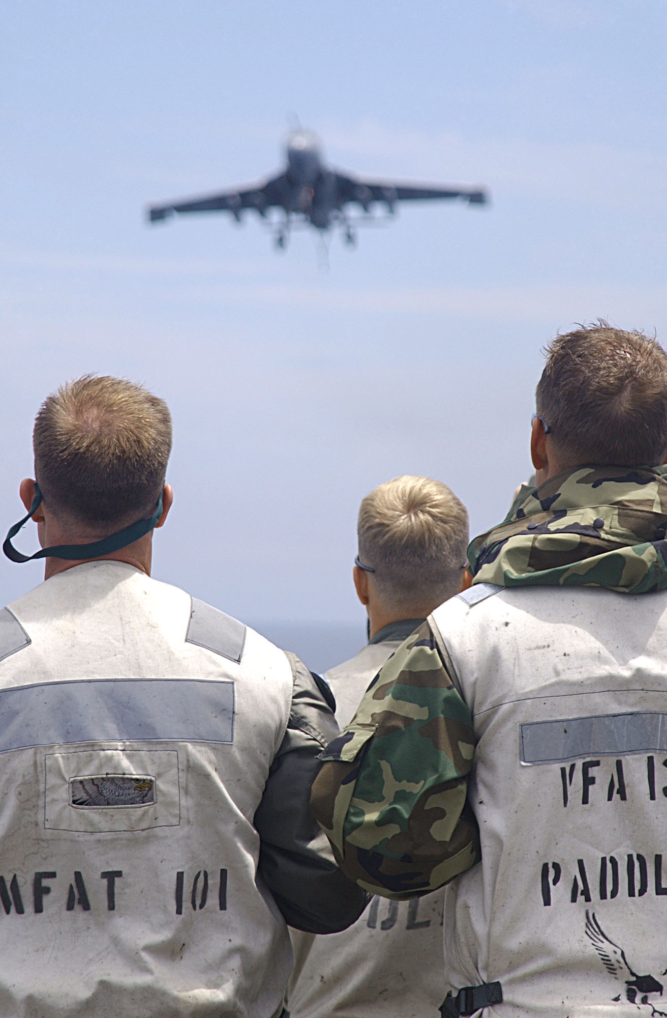 US Navy 030729-N-9769P-031 Landing Signal Officers (LSO) observe the landing of an EA-6B Prowler aboard the nuclear powered aircraft carrier USS John C. Stennis (CVN 74)