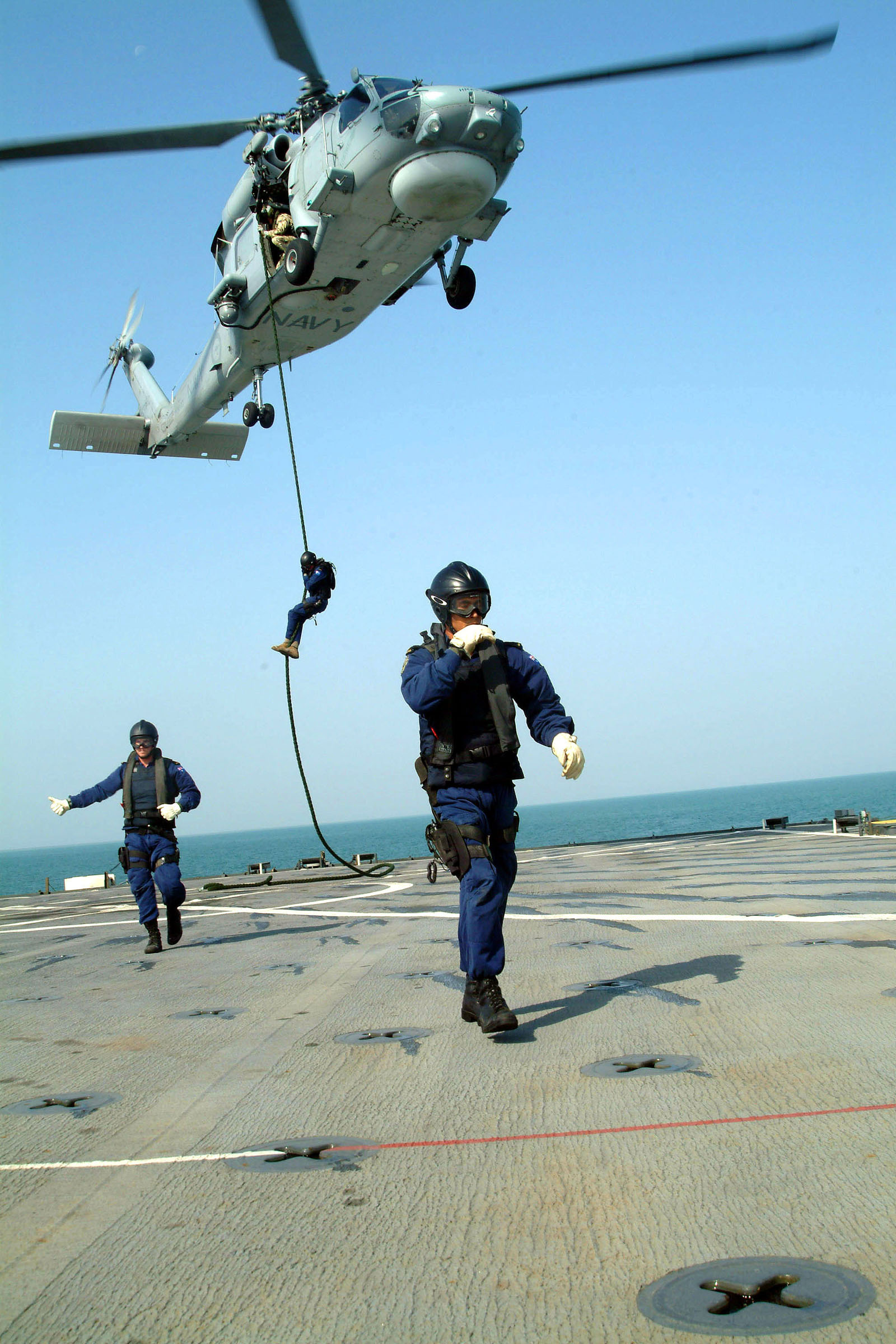 US Navy 041104-N-4772B-058 Boarding team members from the Royal Australian guided missile frigate HMAS Adelaide (FFG 01) conduct a fast rope exercise from an Australian S-70B-2 Seahawk