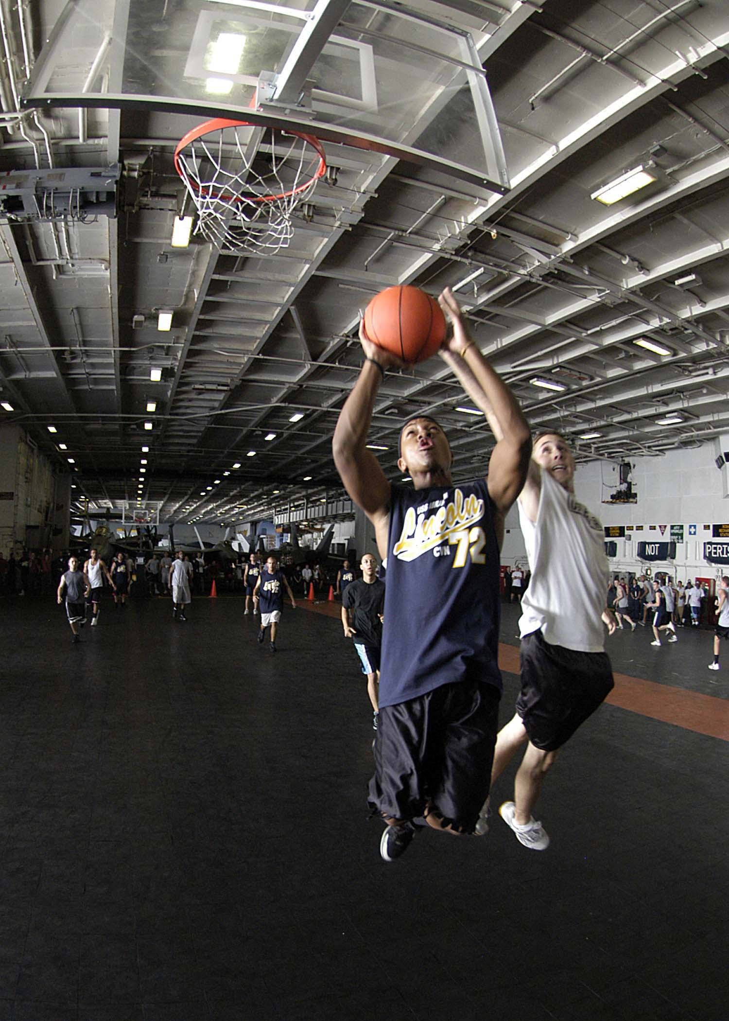 US Navy 050122-N-1229B-146 Sailors aboard USS Abraham Lincoln (CVN 72) participate in a Moral, Welfare and Recreational (MWR) sponsored basketball tournament