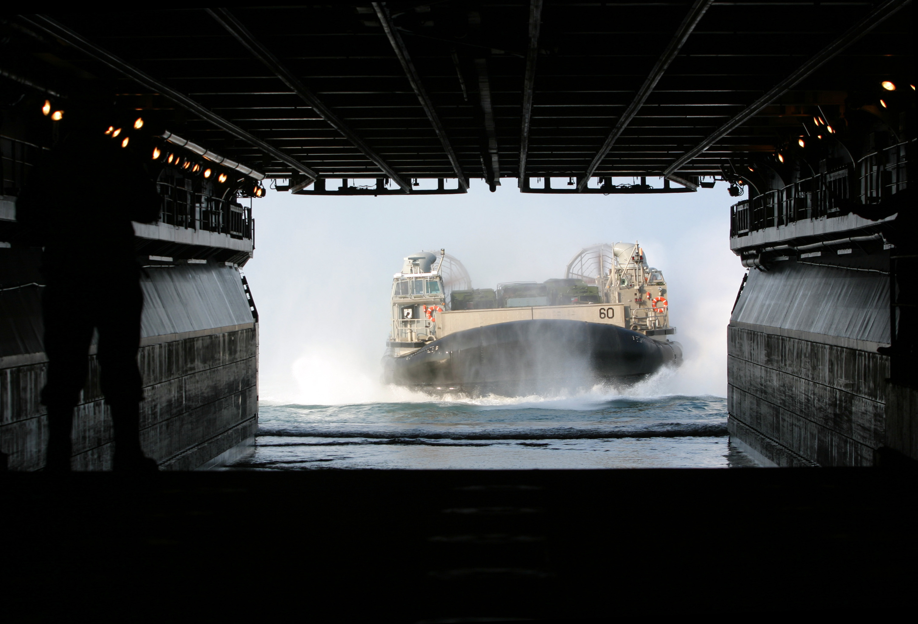 US Navy 050326-M-5900L-004 A Landing Craft, Air Cushion (LCAC), assigned to Assault Craft Unit Four (ACU-4), enters the well deck aboard the amphibious assault ship USS Kearsarge (LHD 3)